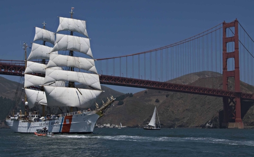 Image of the Coast Guard Cutter EAGLE near the Golden Gate Bridge.